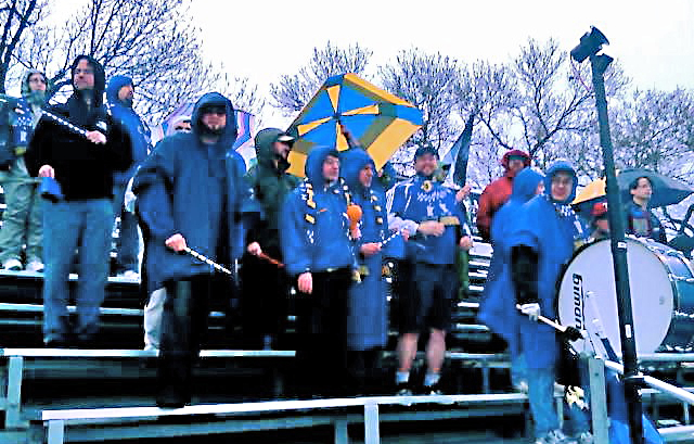 A sparse crowd of Dark Clouds stand in the rain at a game in 2005. Photo by Brian Quarstad