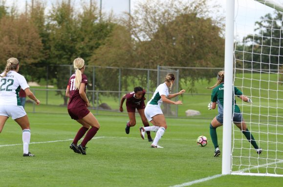 Simone Kolander heads in the first goal in the Gophers 3-0 win over Eastern Michigan. Photo by Jeremy Olson - www.digitalgopher.com