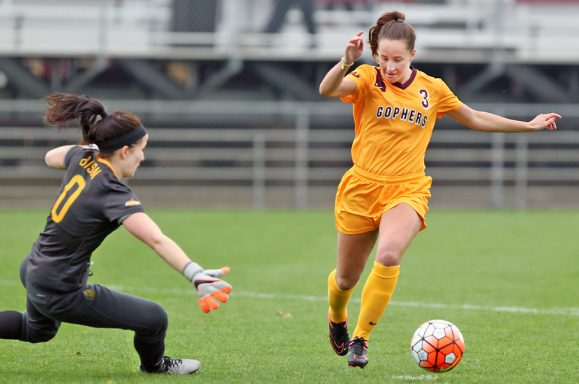 Kellie McGhan rounds a keeper to score her second goal of a Spring Season game.