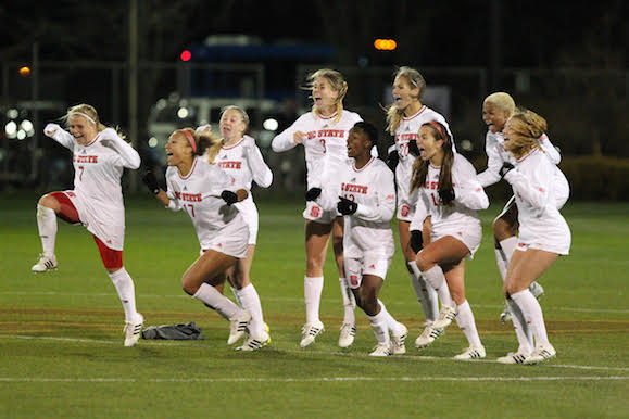 The Wolfpack celebrate their victory and advancement to the second round of the NCAA Tournament.