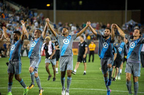 Minnesota United players celebrating after a match at TCF Bank Stadium