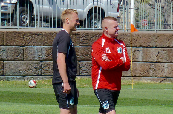 Jack Blake interacting with coach Carl Craig during his trail with Minnesota United