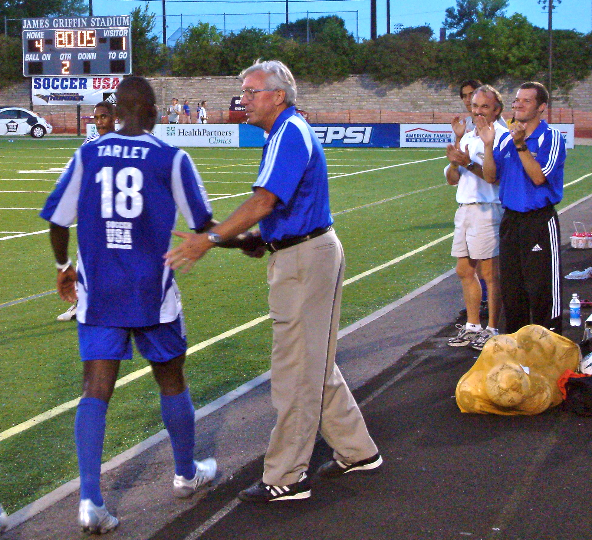 Thunder head coach Buzz Lagos congratulates forward Melvin Tarley for his four-goal performance against the Colorado Rapids in the 2005 U.S. Open Cup Round of 16.