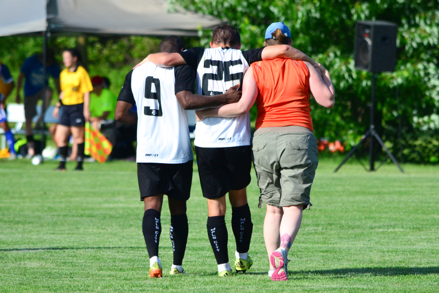 Isaac Friendt is helped off the field. Image courtesy of Daniel Mick.