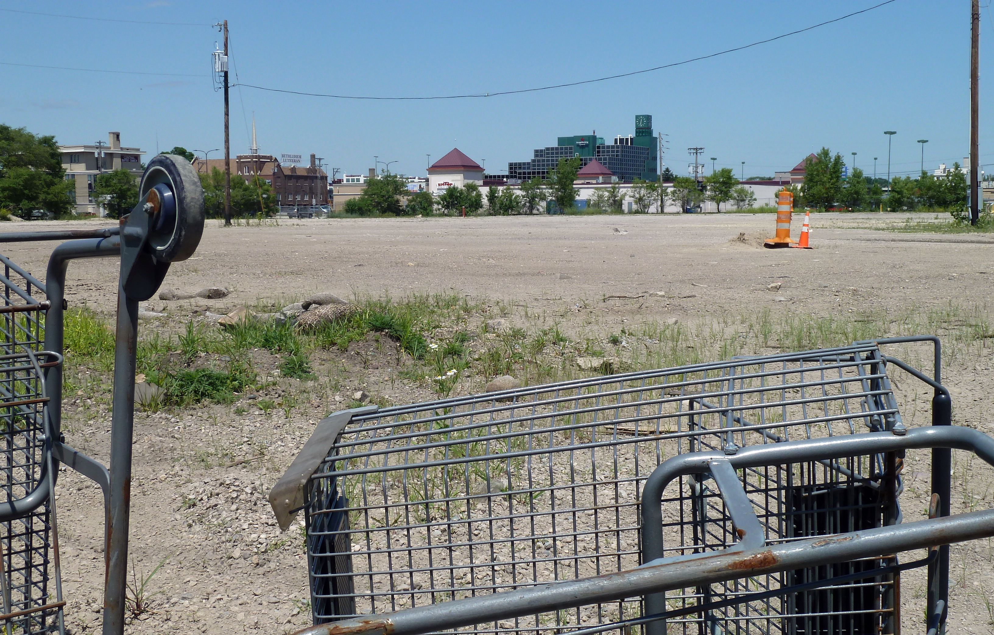 Except for a few shopping carts and cones the Midway's bus barn site is cleared of debris for the first time in 20 years and awaits the OK for EPA cleanup. Photo by Brian Quarstad.